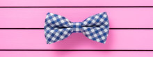 Blue Bow Tie On Pink Background
