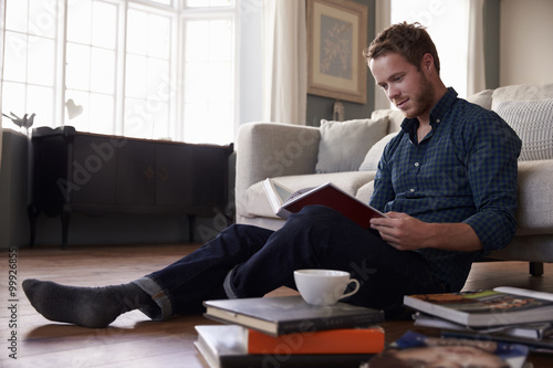 Fotografie, Obraz  Young man reading books