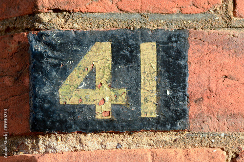 Fotografia  House Number 41 painted sign