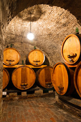 FototapetaOld traditional dark wine cellar with big wooden barrels