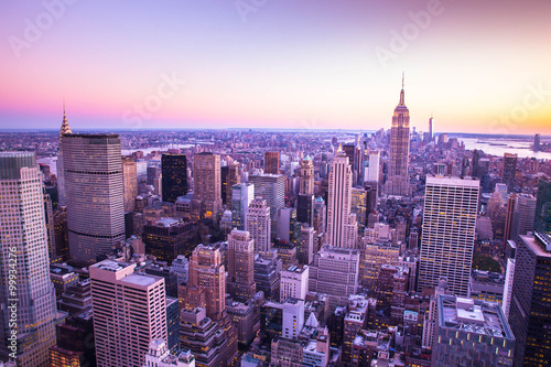 Colorful New York City skyline at sunset