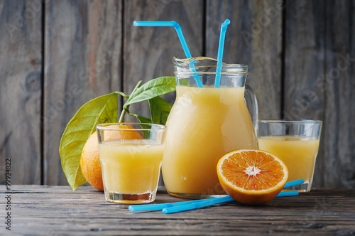 Foto op Canvas Sap Healthy fresh orange juice on the woodent table