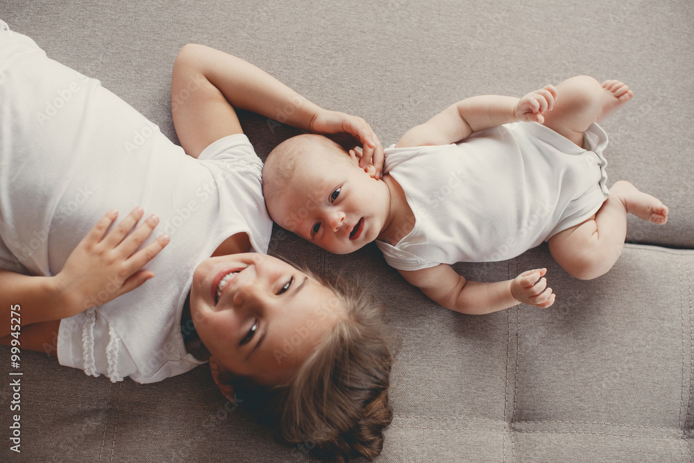 Fototapety, obrazy: Little girl with a newborn baby brother