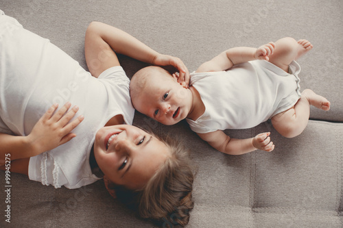 Little girl with a newborn baby brother Poster Mural XXL