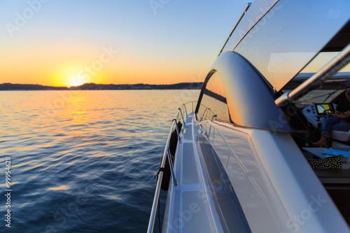 luxury motoryacht at sunset