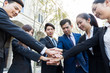 Group of business people hand joining together