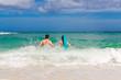 Happy couple having fun on the beach of a tropical island Summe