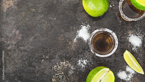 Fotografie, Obraz  Tequila shots with lime slice, top view