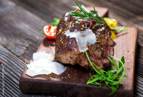 Beef steak on a wooden table. Tablou Canvas