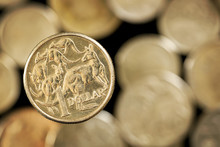 Australian One Dollar Coin Over Blurred Golden Background