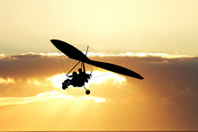 Hang Gliding In The Sky At Sunset