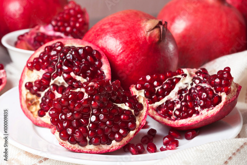 Closeup sliced pomegranate on white plate