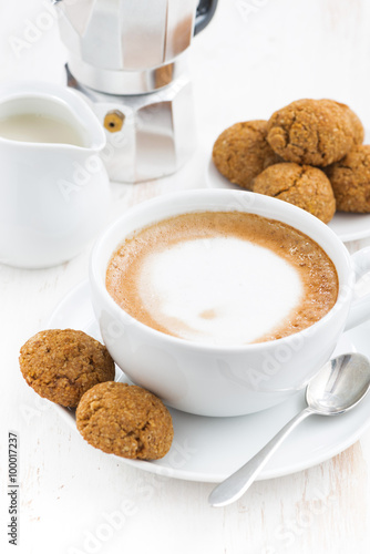 cup of cappuccino and macaroons on white wooden table, closeup Wallpaper Mural