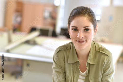 Portrait of young woman architect in design office
