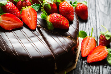 FototapetaChocolate cake with fresh strawberries