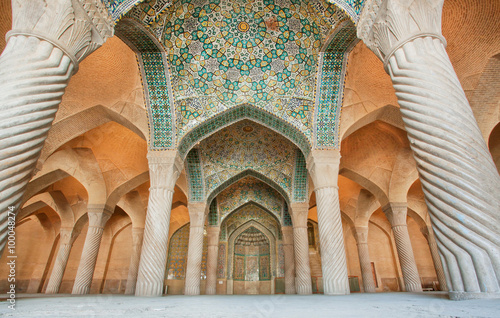 fototapeta na drzwi i meble Persian patterns on the ceiling of mosque with columns and artworks, Iran