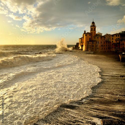 Fotobehang Zwavel geel High waves at sunset on the seafront Camogli
