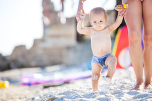 Baby Boy Walking Along Beach W...