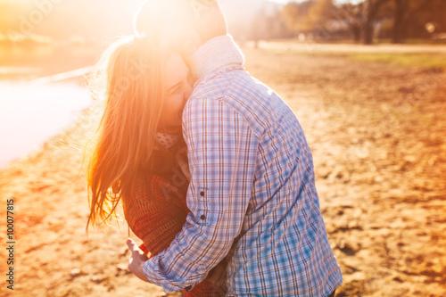 Fotografie, Obraz  Young couple near lake having good time at sunset