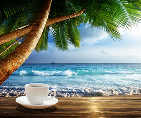 Fototapetabeach and cup of coffee