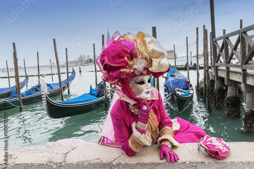 Carnival mask and gondolas in Venice