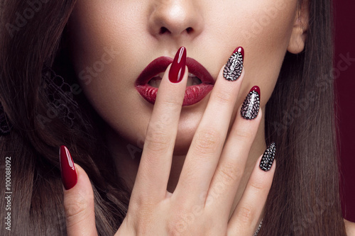 Carta da parati Pretty girl with unusual hairstyle, bright makeup, red lips and manicure design
