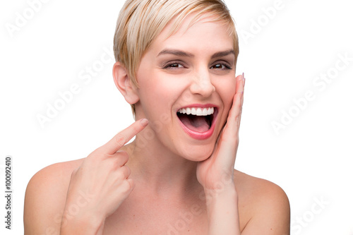 Fotografia  Cute fun laughing female with perfect white teeth straight smile pointing at mou