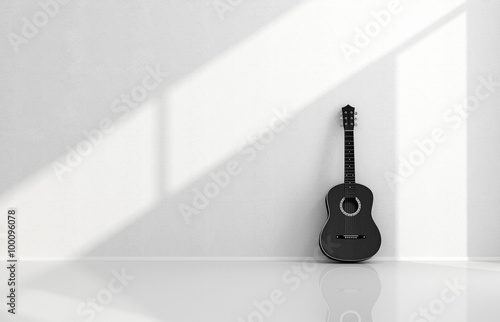 Fotografie, Obraz  Black acoustic guitar in a white room