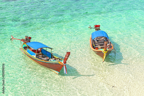 Wall Murals Green coral Two boats floating on a shallow water, tropical holidays concept.