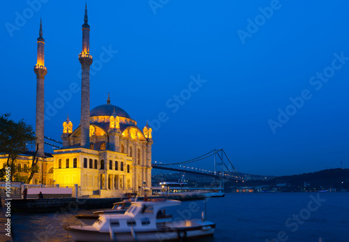 Ortakoy Mosque in night lights, in the background the bridge over the Bosphorus, Poster