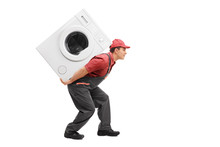 Worker Carrying A Washing Machine On His Back