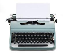 Vintage Typewriter With Blank Paper