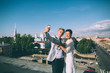 Pair of lovers newlyweds on the roof of the city makes selfie