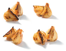 Roasted Onion Pieces On A White Background. Closeup
