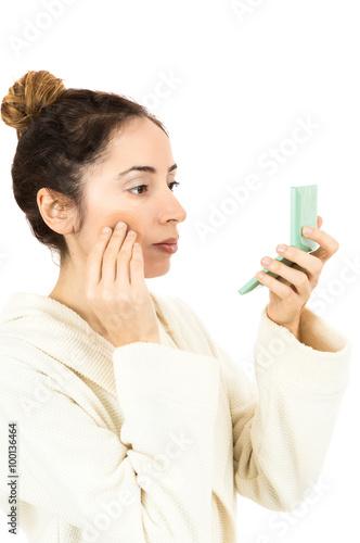 Fotografie, Obraz  Woman using her make up sponge