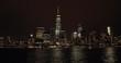New York City night skyline from cruise boat
