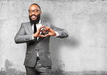 Business Black Man Doing A Heart Sign