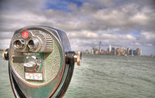 Binocular Pointed At The Southern Area Of Manhattan, New York City (NYC) In HDR On Cloudy Sky. Selective Focus. Image Taken From An Observation Deck At Liberty Island