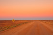 canvas print picture - Evening in the Australian Outback, dirt road near Coober Pedy