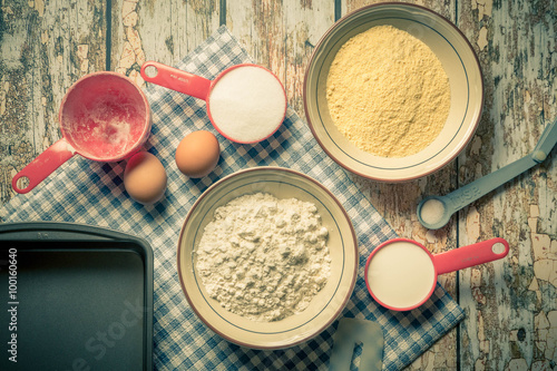Fotografie, Obraz  Arrangement of a variety of baking ingredients and utensils with vintage tone filter effect