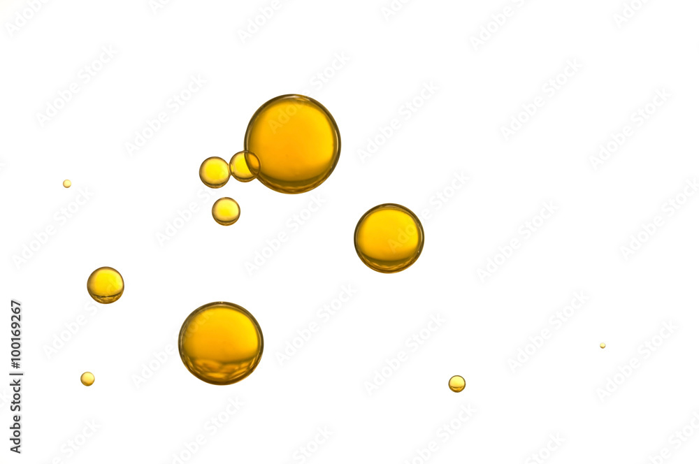 Fototapeta Yellow air bubbles isolated over a white background