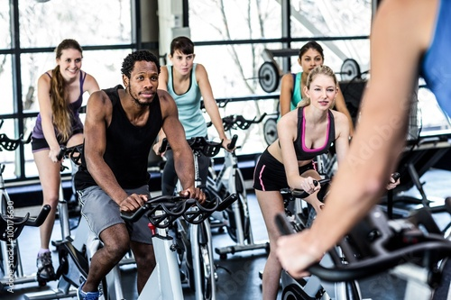 Canvas Print Fit people working out at spinning class