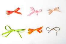 Colorful Bows On The White Background