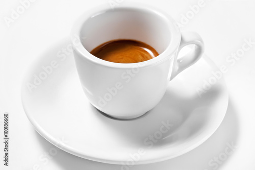 фотография A cup of coffee on a plate isolated on white background