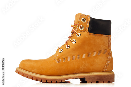 Fotografiet yellow winter boot isolated on white