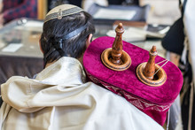 Jewish Man Praying In A Synagogue With The Bible - Torah