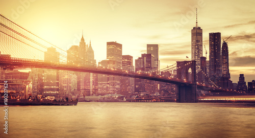 Retro stylized Manhattan at sunset, New York, USA.
