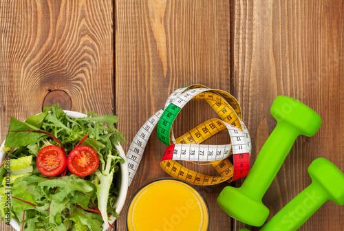 Foto op Plexiglas Fitness Dumbells, tape measure and healthy food over wooden table