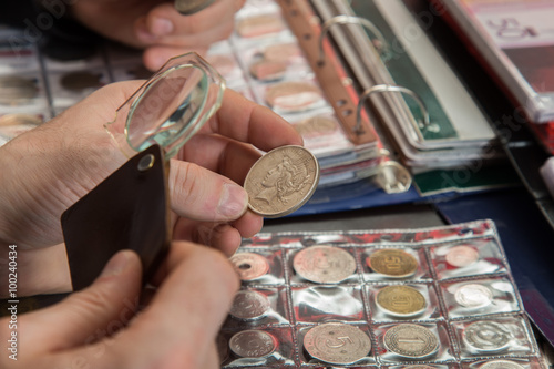 Fotografie, Tablou  Two numismatists examines  collection of coin
