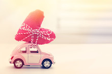 Miniature Car Carrying Red Hea...